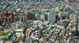 Aerial view of Tokyo City, tall buildings and homes and the city's growth..