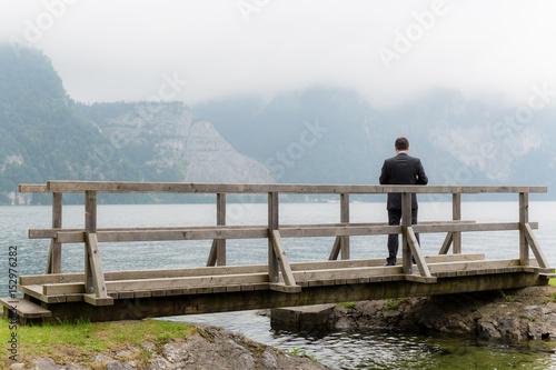 Groom waiting at bridge