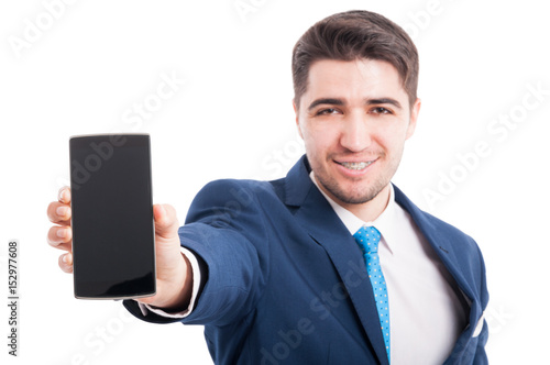 Happy entrepreneur holding smartphone with blank screen