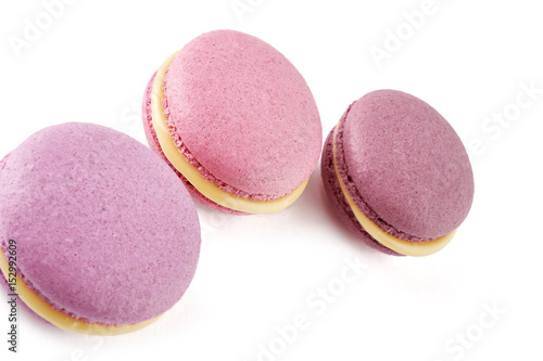 Foto op Aluminium Macarons Colorful French almond cookies macarons or macaroons isolated on white background. Top view.