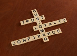 Crossword puzzle with words Trust, Loyalty, Confidence. Customer loyalty concept.