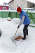 shoveling snow woman while - 153005055