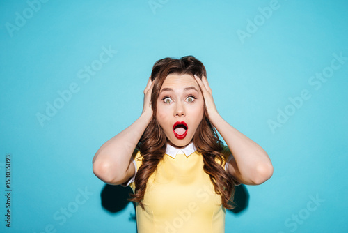 Portrait of a surprised shocked woman in dress
