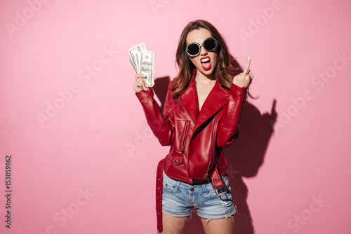 Rude crazy girl in leather jacket holding money banknotes Poster