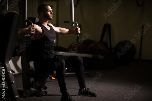 Sporty sexy men with great abdominal muscles in black sportswear