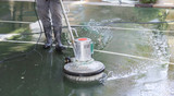 cleaning the floor with polishing machine - 153064007