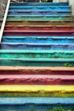 Steps of old street stairway painted with different colors