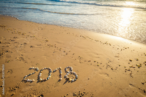 Poster 2018 New Year text on sand