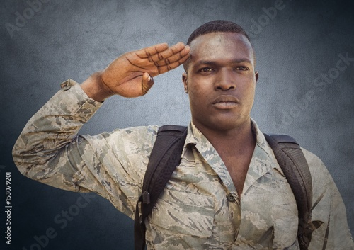 Soldier saluting against navy Poster