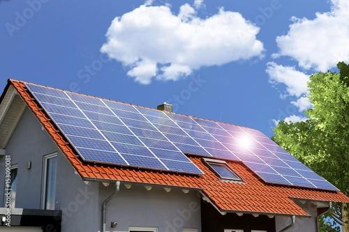 Fototapeta Roof with solar panels