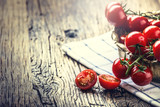 Fresh cherry tomatoes. Ripe tomatoes on oak wooden background.