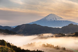 Mountain fuji san at sunrise with fog