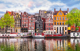 Amsterdam Netherlands dancing houses over river Amstel landmark © Yasonya