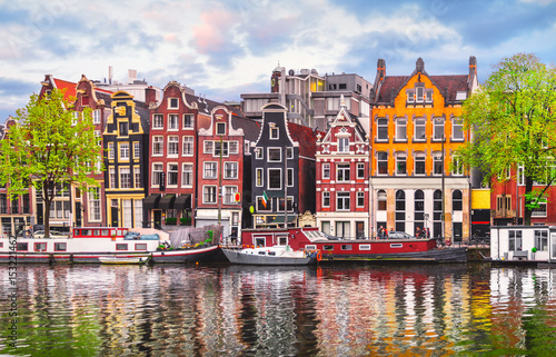 Fotobehang Lente Amsterdam Netherlands dancing houses over river Amstel landmark