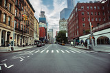Fototapety New York City street road in Manhattan at summer time. Urban big city life concept background.