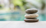 Natural zen stone over blurred background, outdoor day light - 153327831