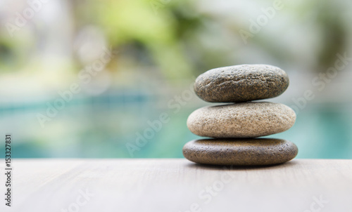 Fotobehang Spa Natural zen stone over blurred background, outdoor day light