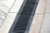 Rainwater drainage system on a sidewalk - 153378673