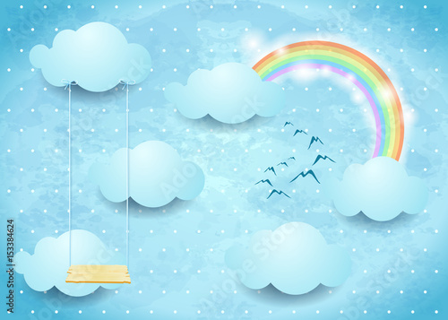 Surreal sky with clouds, rainbow and swing
