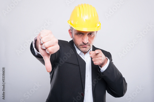 Foreman making thumb down gesture and pointing