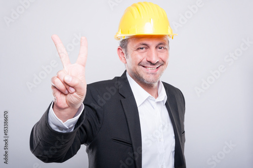Portrait of engineer wearing hardhat showing peace