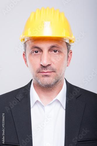 Portrait of handsome engineer wearing hardhat