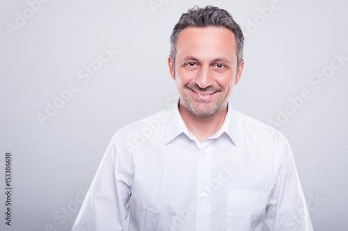 Engineer posing wearing white shirt and smiling