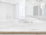 Background of blurred bathroom interior with wooden table in front - 153395425