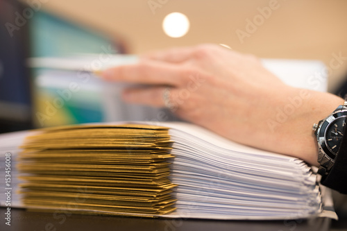 Female hand with files or dossiers