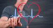 Man touching a heart beats graph on a touch screen - 153461881