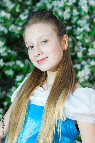 Plakat Girl in a blue dress in nature