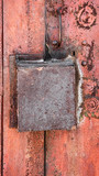 old rusty metal background with a box lock. The vertical frame.