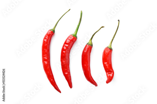 Aluminium Hot chili peppers line of hot chili peppers on white background
