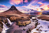 Spring sunrise over the famous Kirkjufellsfoss Waterfall with Kirkjufell mountain in the background in Iceland