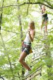 friends having fun climbing in the trees