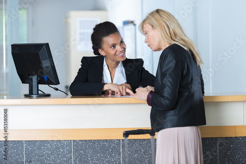 mature woman at hotel reception
