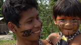 Father and Son at an indigenous tribe in the Amazon - 153580641