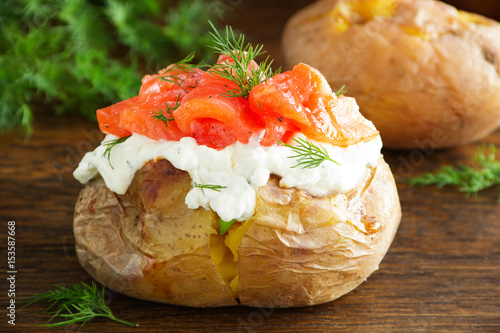 Baked potato with cream of the cream cheese and salted salmon, closeup. - 153587668