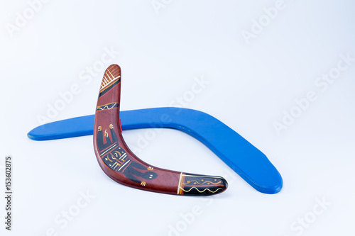 Two boomerangs, a blue and a aboriginal ornamented crossing isolated on white ba Poster