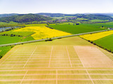 Aerial view to experimental fields with genetic modification plants. Agricultural landscape from above.