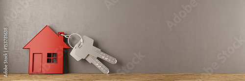 Leinwandbild Motiv Schlüssel mit Haus an Wand gelehnt