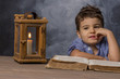 little boy with book and lantern - 153794253