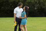Portrait of beautiful sensual couple flirting outdoor in the green park - 153828643