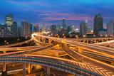 Beautiful Shanghai city with interchange overpass at nightfall in Shanghai, China.