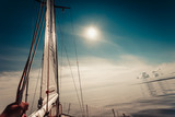 Yachting on sail boat during sunny weather - 153852442