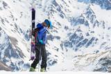 Female skier walking and looking down