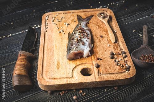 fresh fish on chopping Board