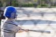 Young boy practicing hitting baseball at the batting cages