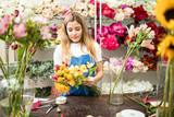 Female florist designing a flower bouquet