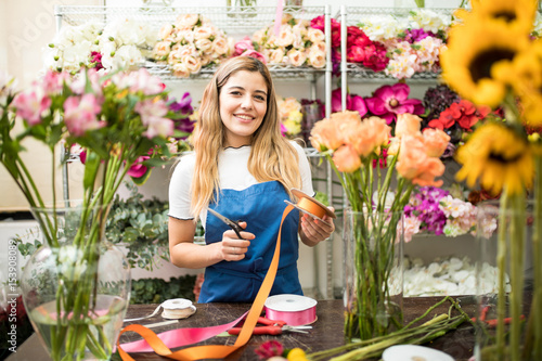 Happy worker surrounded by flowers